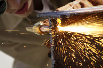 Cropped image of man welding