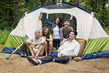 Group portrait in front of tent