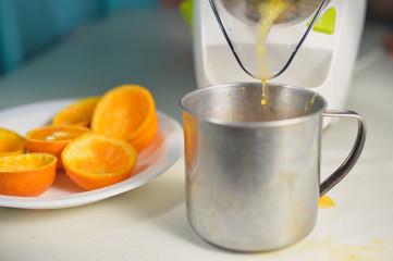 Orange juice maker squeezer closeup