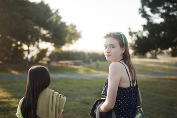 Young girls (8-9,  12-13) in park