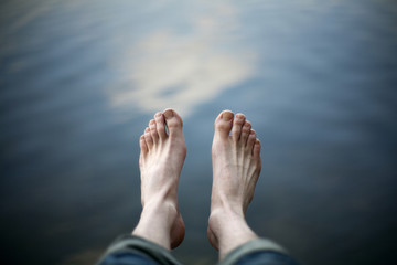 Bare feet above water