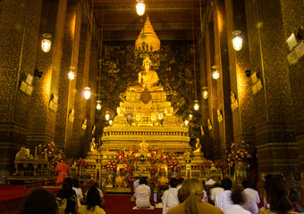 Priests and people are meditating in church at wat-pho bangkok c
