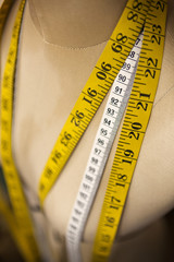 Close-up of mannequin with tape measure