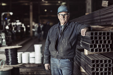 Portrait of worker standing in factory
