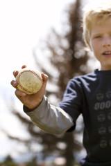 Boy holding baseball