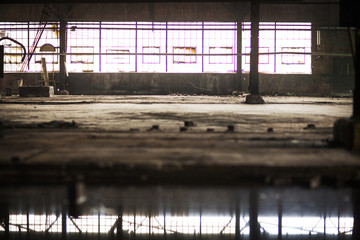Big puddle in abandoned warehouse