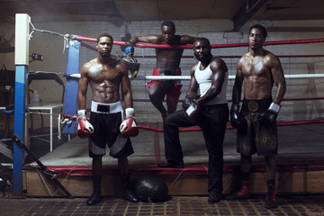 Portrait of male boxers standing by boxing ring