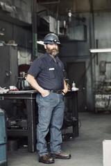 Portrait of senior worker standing in the workshop