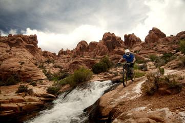 Mountain biker riding in mountains
