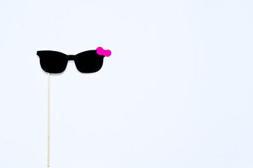 sign-shaped glasses on white background