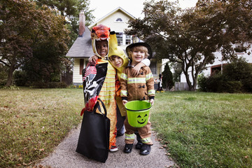 Portrait of children dressed in Halloween costume