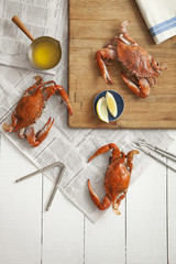 Overhead view of red crabs on table