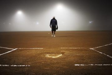 Athlete walking in baseball field