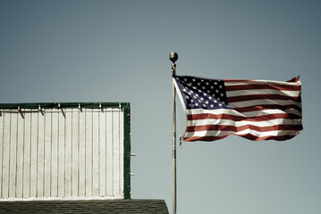Waving American Flag against clear sky