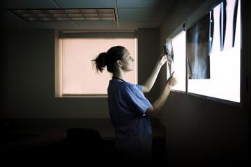 Nurse examining x ray