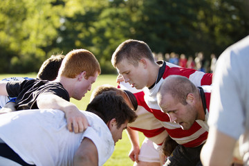 Players playing rugby in field