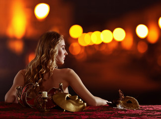 young beautiful blonde with a gold Venetian mask