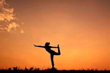 Silhouette women yoga at sky sunset