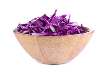Division cut red cabbage over  in a wooden cup on white backgrou