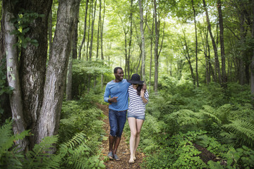 Smiling couple walking in forest