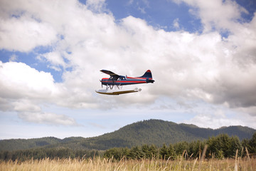 Seaplane flying over landscape