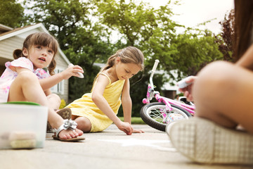 Children drawing on sidewalk