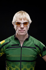 Portrait of man sportsperson standing against black background