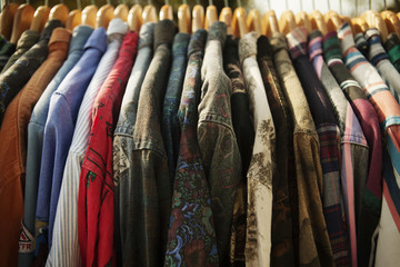 Close-up of various shirts hanging in clothes rack