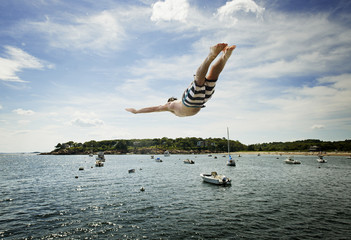 USA, Massachusetts, Magnolia, Young man jumping into water