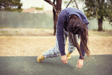Young woman hanging on swing