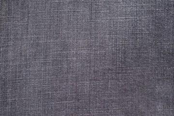 textured background from denim of violet color