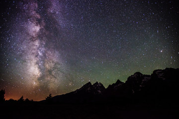 Scenic view of starry sky over mountains
