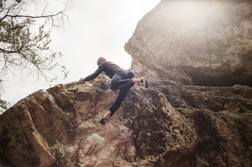 Low-angle view of rock climber