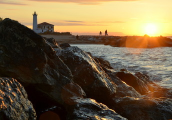 lighthouse by sunrise