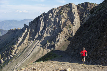 Young athlete running on mountain
