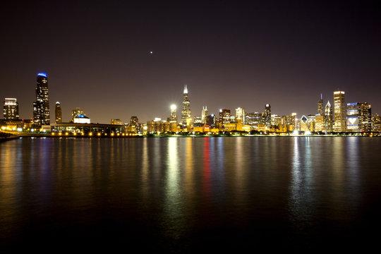 Skyline reflecting in harbor at night
