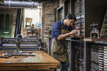Worker working in print workshop