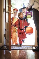 Children (2-3,  4-5,  8-9) on Halloween