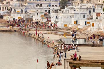 People at Pushkar lake against town