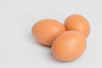 three eggs on white background,three eggs on fabric background, closeup three eggs