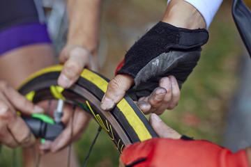 Men repairing bicycle tire