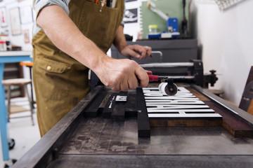 Printmaker working in workshop