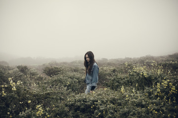 Woman in scrubland