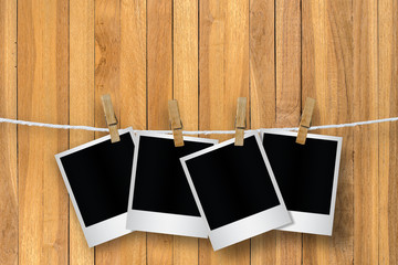 Blank photo frame with clothespin hanging.