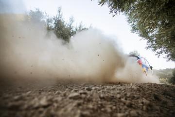 Dust behind car on dirt track