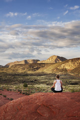 Woman meditating on valley rock,
