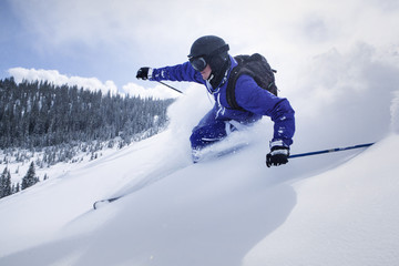 Skier  on snow covered mountain against sky