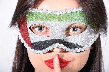 Girl wearing UAE flag mask