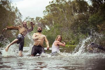 Friends enjoying in river