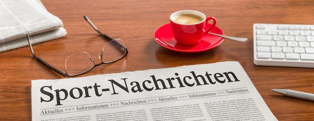 Zeitung auf Schreibtisch - Sportnachrichten